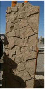 Architectural panel finish simulating sandstone rock
