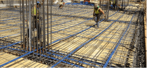 One-way slab and beam floor system. Slab tendons placed parallel with the slab span